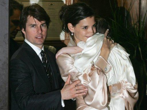 Actors Tom Cruise (L) and Katie Holmes (R), holding their daughter Suri, leave a restaurant in central Rome days before their wedding in 2006. The couple announced Friday they were calling it quits after five years of marriage, ending an unexpected love story dogged by tabloid rumors