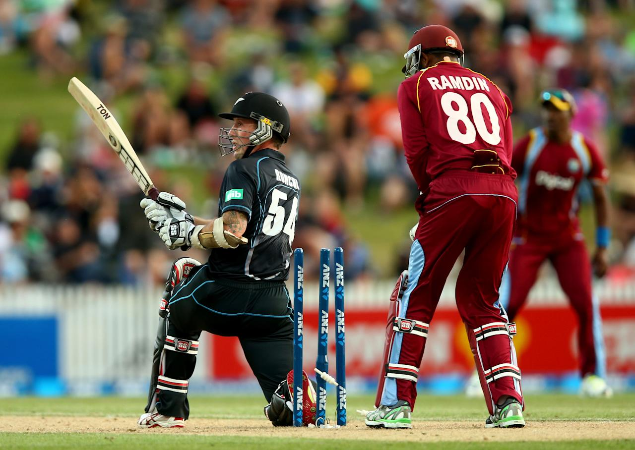 HAMILTON, NEW ZEALAND - JANUARY 08: Luke Ronchi of New Zealand puts his foot through the wickets to be dismissed during game five of the One Day International Series between New Zealand and the West Indies at Seddon Park on January 8, 2014 in Hamilton, New Zealand.  (Photo by Phil Walter/Getty Images)