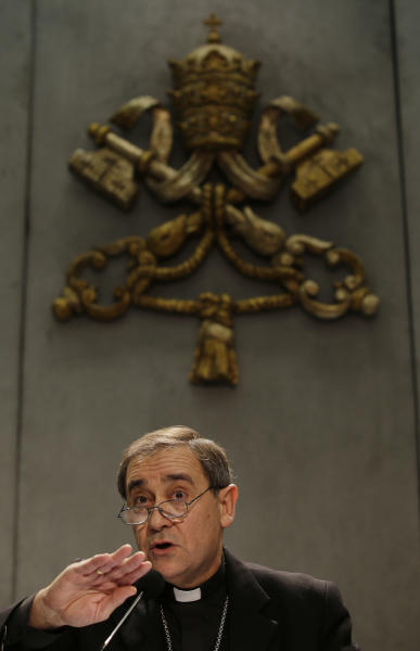 Bishop Juan Ignacio Arrieta gestures during a press conference at the Vatican, Friday, Feb. 22, 2013. Pope Benedict XVI may enact a new law governing the upcoming conclave to elect a new pope amid continued uncertainty over when the voting can begin. Lombardi, said Wednesday that he didn't know for sure if the new law under consideration would address the timing of the conclave following Benedict's Feb. 28 resignation. (AP Photo/Gregorio Borgia)