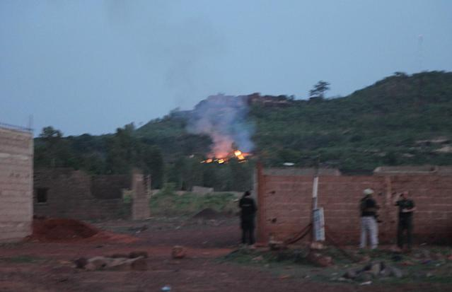 <p>Fire can be seen by the swimming pool of the Campement Kangaba, a tourist resort near Bamako, Mali, Sunday, June 18, 2017. Suspected jihadists attacked the hotel resort Sunday in Mali's capital, taking hostages at a spot popular with foreigners on the weekends. (AP Photo/Baba Ahmed) </p>