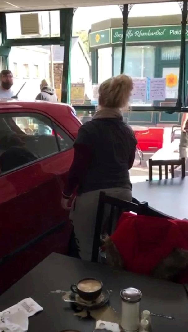 Customers escaped death by inches after a runaway car ploughed through the front of a busy cafe while they were eating breakfast. Ricky Garrett, 67, and his family had just moved to a warmer table when the red Kia Picanto smashed through the front window of the shop and into their former seats. Multiple tables was smashed to pieces, and son Aaron, 34, fractured his thumb while pulling his mum Susan, 66, out of the path of the out of control car. Diners were pushed up against the walls by the force of the crash - but miraculously all seven customers and two staff members escaped without major injury.