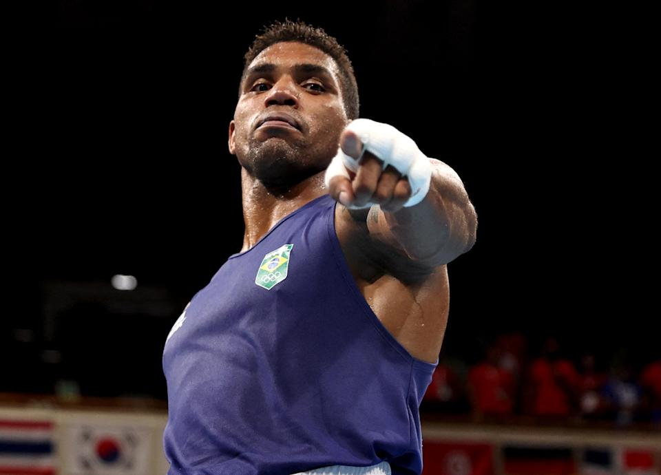 <p>Brazil's Abner Teixeira celebrates after winning his men's heavy (81-91kg) quarterfinal boxing match on July 30.</p>