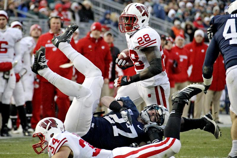 Wisconsin linebacker Derek Watt (34) blocks Penn State safety Jacob Fagnano (27) as Wisconsin running back Montee Ball (28) runs for a touchdown during the first quarter of an NCAA college football game in State College, Pa., Saturday, Nov. 24, 2012. (AP Photo/Gene J. Puskar)