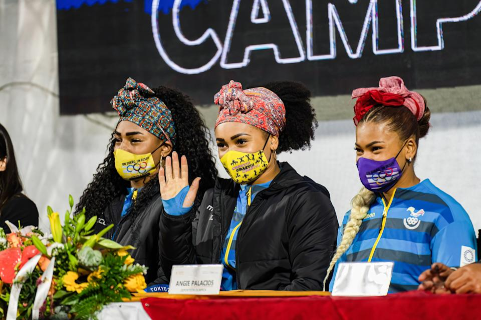 QUITO, ECUADOR - 2021/08/04: Neisi Dajomes, Tamara Salazar and Angie Palacios seen at the Atahualpa Olympic Stadium for the welcome home event. Ecuadorians celebrate the return of three athletes following two medals and one olympic diploma in the 2020 Tokyo Olympics. (Photo by Vincent Ricci/SOPA Images/LightRocket via Getty Images)