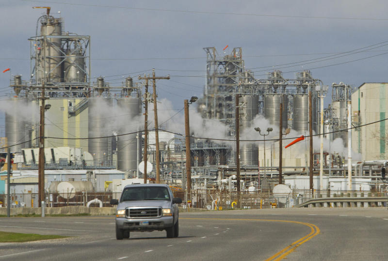 A pick-up truck drives along Independence Parkway near oil refineries and storage facilities south of downtown Houston Jan. 30, 2012. (Richard Carson / Reuters)