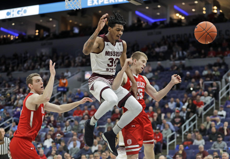 Missouri State's Tulio Da Silva (30) loses control of the ball on his way to the basket past Bradley's Luuk van Bree, left, Nate Kennell during the first half of an NCAA college basketball game in the quarterfinal round of the Missouri Valley Conference tournament, Friday, March 8, 2019, in St. Louis. (AP Photo/Jeff Roberson)