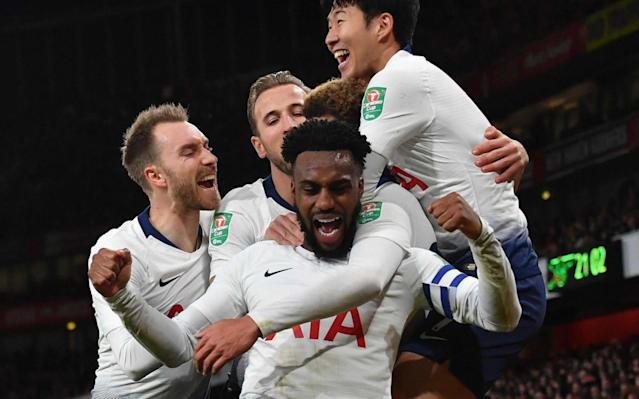 Danny Rose celebrates with his Spurs teammates after Dele Alli had doubled their lead at the Emirates - AFP