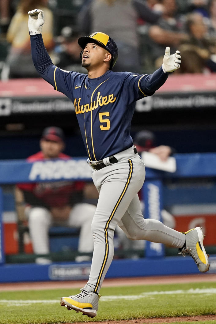 Milwaukee Brewers' Eduardo Escobar celebrates after hitting a solo home run in the fifth inning of a baseball game against the Cleveland Indians, Friday, Sept. 10, 2021, in Cleveland. (AP Photo/Tony Dejak)