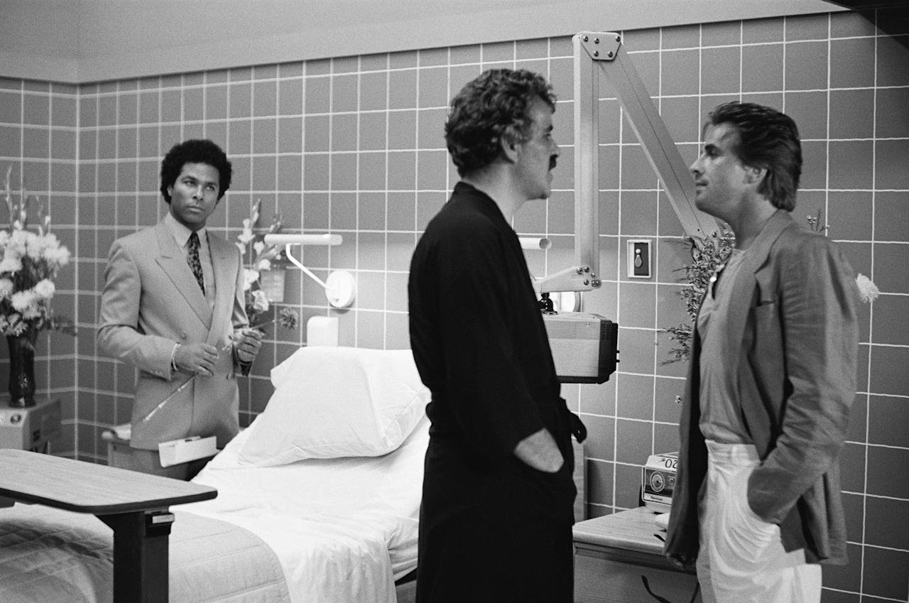 "Philip Michael Thomas as Detective Ricardo 'Rico' Tubbs,  Dennis Farina as Albert Lombard and Don Johnson as Detective James 'Sonny' Crockett in the ""Miami Vice"" episode, ""Lombard."""
