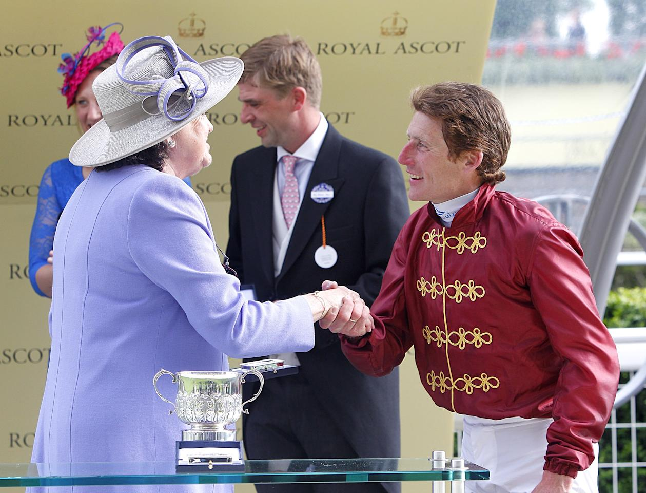 Jockey Johnny Murtagh is awarded his trophy by Lady Rachel Oaksey after winning the Windsor Castle Stakes during day one of the Royal Ascot meeting at Ascot Racecourse, Berkshire.