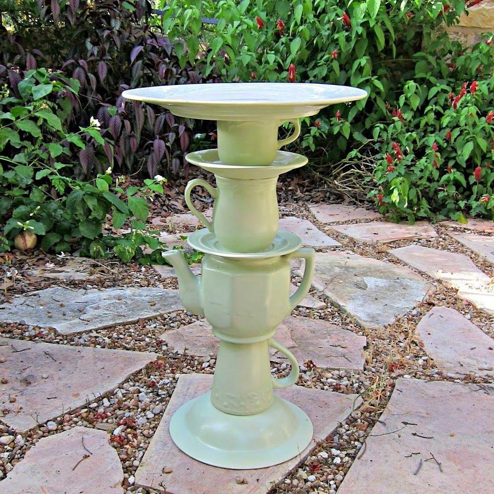 """<p>With some paint and glue, old teapots and dishes become a perfect garden decoration to let birds to join in on the Easter fun.</p><p><em><a href=""""https://www.morenascorner.com/2013/07/diy-tea-pot-bird-bath.html?fbclid=IwAR2JgAgzly17WEQpEIV5Mc6qQFeNvKy3-a5zzl4YaLY-8SMYlKrTHQ8YOLI"""" rel=""""nofollow noopener"""" target=""""_blank"""" data-ylk=""""slk:Get the tutorial at Morena's Corner »"""" class=""""link rapid-noclick-resp"""">Get the tutorial at Morena's Corner »</a></em></p>"""