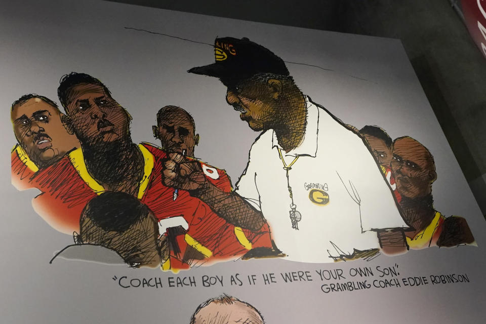 Artwork showing legendary Grambling football coach Eddie Robinson is displayed at the College Football Hall of Fame, Thursday, Sept. 2, 2021, in Atlanta. The Hall has a new exhibit dedicated to historically black colleges and universities. (AP Photo/John Bazemore)