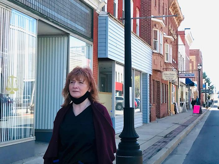 Jackie Hickey Butts, standing on Main Street in Keyser, West Virginia, recalls how much she struggled to take care of her family on minimum wage.