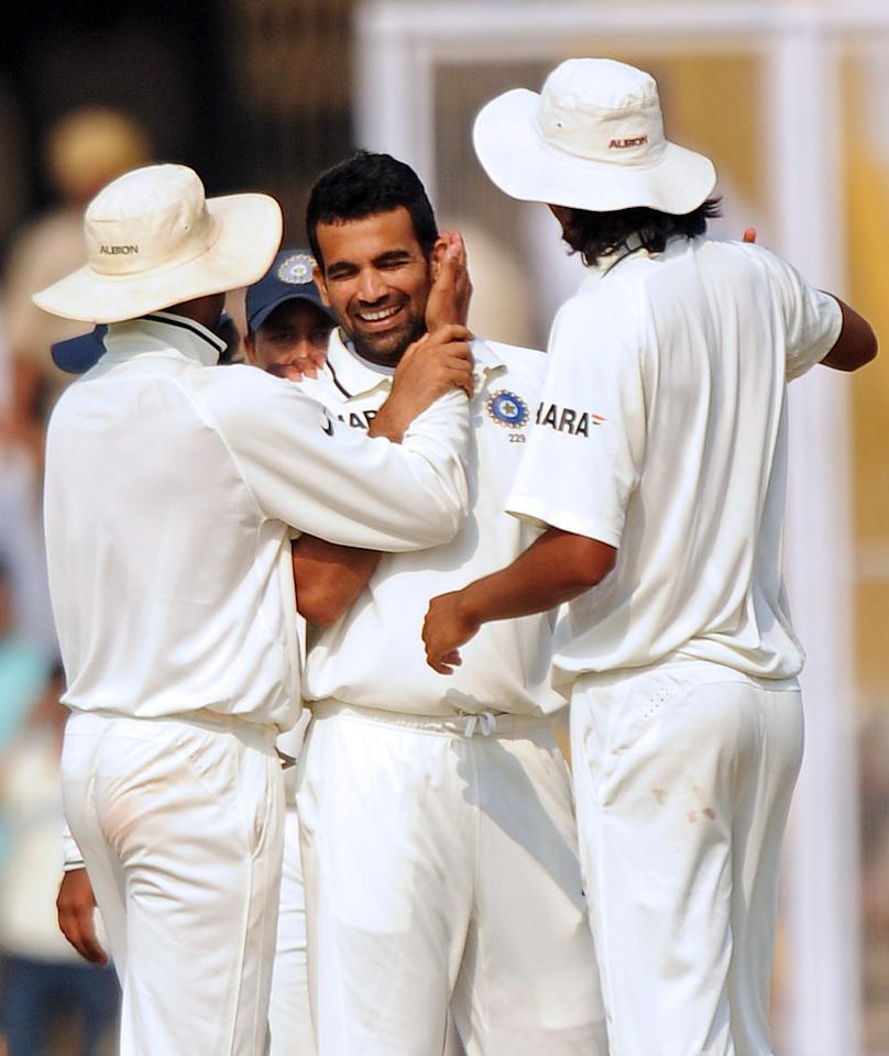 Indian cricketers congratulate teammate Zaheer Khan(C) as they celebrate the wicket of Australian cricketer Nathan Hauritz during the fourth day of the first Test between India and Australia in Mohali on October 4, 2010. In their second innings Australia were 165 runs for the loss of six wickets in 50 overs.   AFP PHOTO / Dibyangshu SARKAR (Photo credit should read DIBYANGSHU SARKAR/AFP/Getty Images)