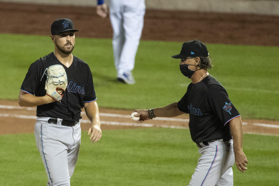 Miami Marlins pitcher Daniel Castano passes Miami Marlins manager Don Mattingly as he leaves during the fifth inning of a baseball game against the New York Mets Saturday, Aug. 8, 2020, in New York. (AP Photo/Frank Franklin II)