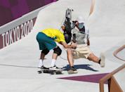<p>Kieran Woolley of Team Australia crashes into a TV Cameraman during the Men's Skateboarding Park Preliminary Heat 3 on day thirteen of the Tokyo 2020 Olympic Games at Ariake Urban Sports Park on August 05, 2021 in Tokyo, Japan. (Photo by Jamie Squire/Getty Images)</p>