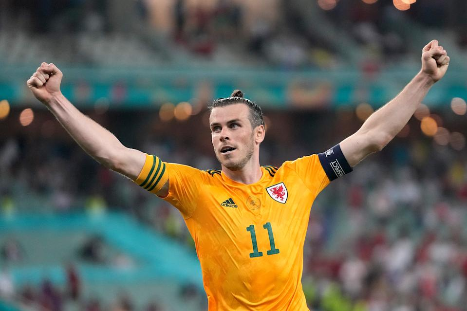 BAKU, AZERBAIJAN - JUNE 16: Gareth Bale of Wales celebrates after their side's second goal scored by Connor Roberts (Not pictured) during the UEFA Euro 2020 Championship Group A match between Turkey and Wales at Baku Olimpiya Stadionu on June 16, 2021 in Baku, Azerbaijan. (Photo by Darko Vojinovic - Pool/Getty Images)