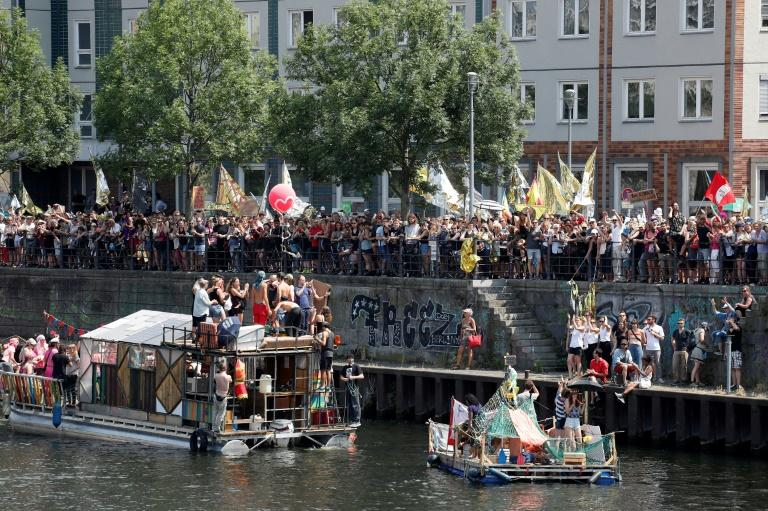 """One of the loudest counter-demos was organised by some 100 clubs from Berlin's legendary techno scene, who were using boats and floats on the river Spree and a convoy of DJ-carrying trucks to """"bass away"""" the AfD"""