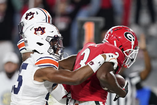 Georgia running back Zamir White (3) scores a touchdown against Auburn linebacker Cam Riley (35) during the first half of an NCAA college football game Saturday, Oct. 3, 2020, in Athens, Ga. (AP Photo/Brynn Anderson)