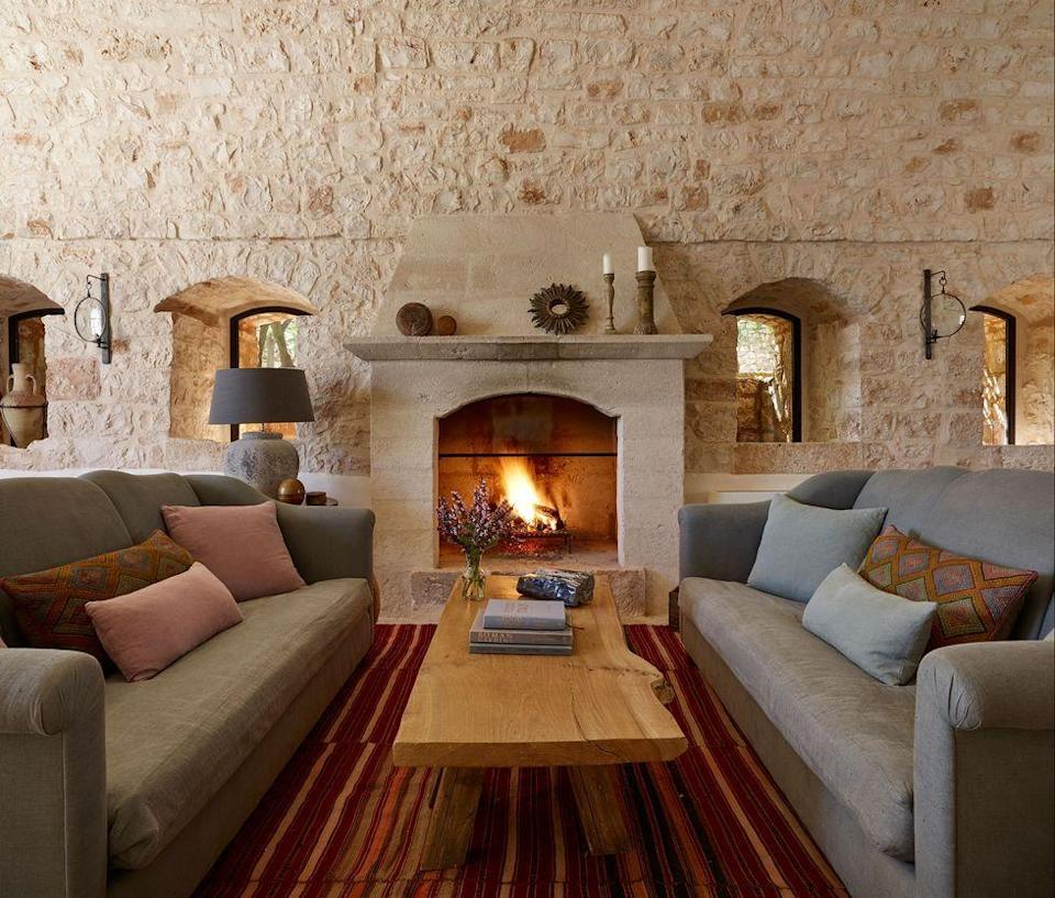 """<p>This <a href=""""https://www.elledecor.com/design-decorate/house-interiors/a35491380/james-thurstan-waterworth-puglia-farmhouse/"""" rel=""""nofollow noopener"""" target=""""_blank"""" data-ylk=""""slk:Italian farmhouse"""" class=""""link rapid-noclick-resp"""">Italian farmhouse</a> features green and blue sofas that are topped with mismatched yet complementary cushions—colors that all work for autumn. </p>"""