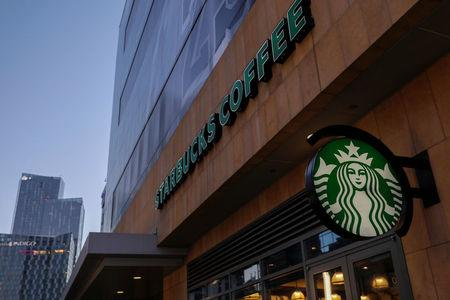 A Starbucks sign is show on one of the companies stores in Los Angeles, California