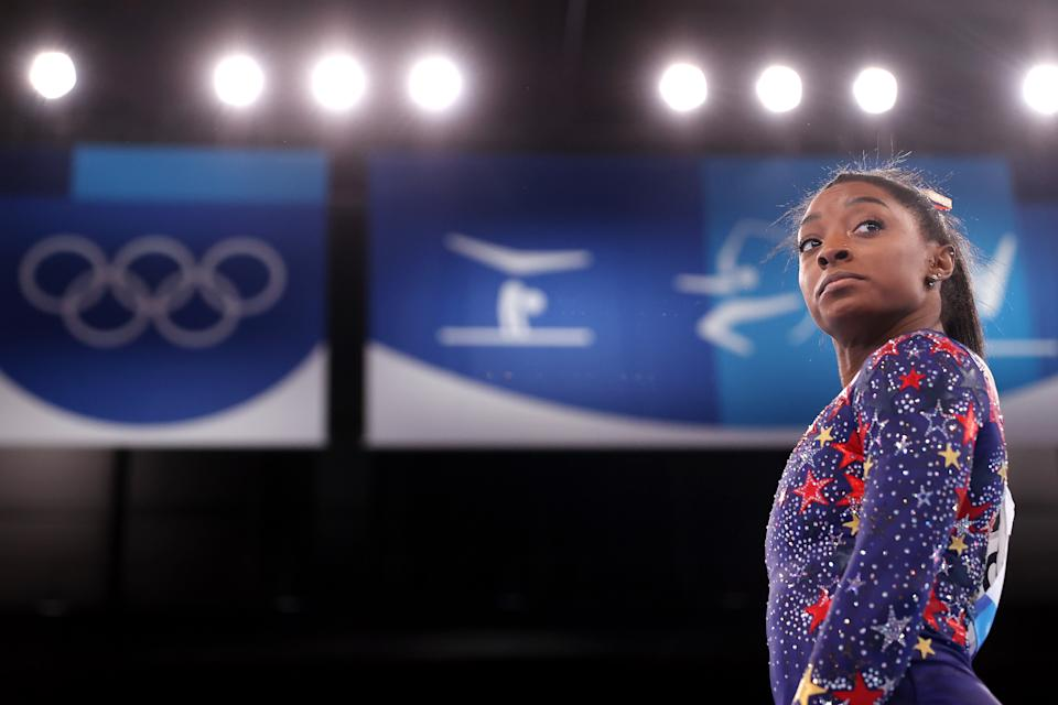 TOKYO, JAPAN - JULY 25: Simone Biles of Team United States looks on during Women's Qualification on day two of the Tokyo 2020 Olympic Games at Ariake Gymnastics Centre on July 25, 2021 in Tokyo, Japan. (Photo by Laurence Griffiths/Getty Images)