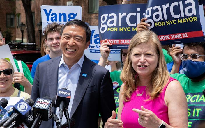Andrew Yang and Kathryn Garcia, Democratic candidates for New York City Mayor, speak during a campaign appearance in New York City - Reuters