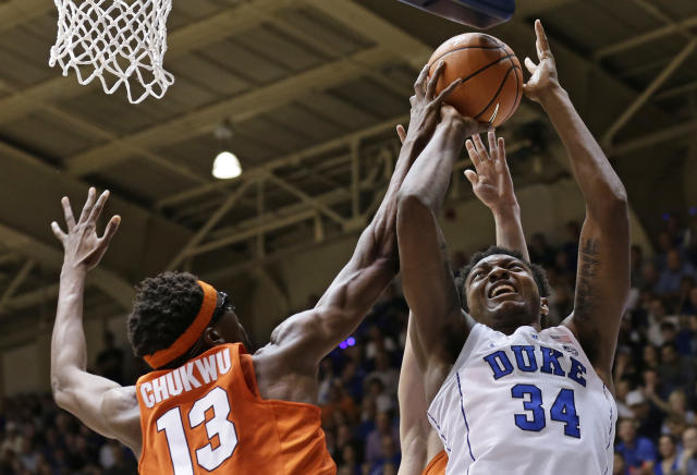 Duke's Wendell Carter Jr. (34) shoots while Syracuse's Paschal Chukwu (13) defends during the first half of an NCAA college basketball game in Durham, N.C., Saturday, Feb. 24, 2018. (AP Photo/Gerry Broome)