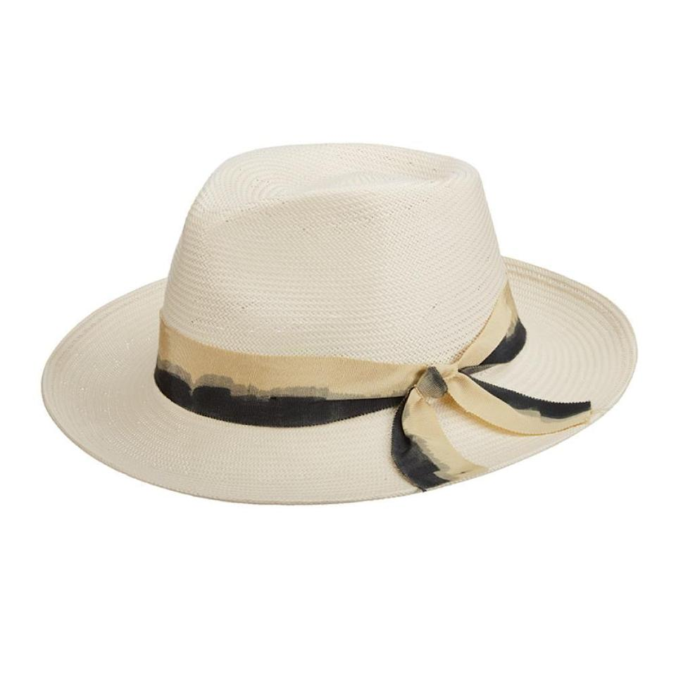 "<p>tenthstreethats.com</p><p><strong>$95.00</strong></p><p><a href=""https://tenthstreethats.com/products/brooklyn-straw-summer-fedora-hat-cape-may?variant=5488867737631"" rel=""nofollow noopener"" target=""_blank"" data-ylk=""slk:Shop Now"" class=""link rapid-noclick-resp"">Shop Now</a></p><p>Make sure she hits the beach wearing this stylish topper, accentuated with dip dyed ribbon trim. </p>"