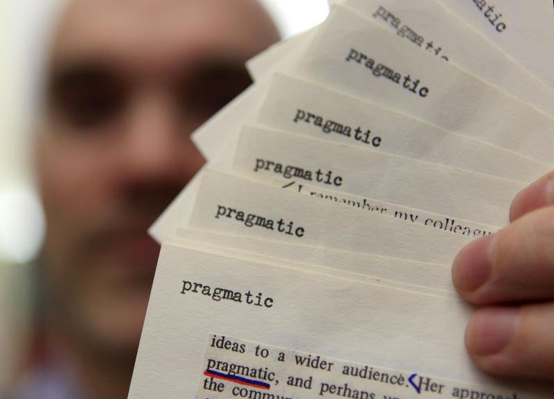 "In this Tuesday, Dec. 14, 2010 photo, Peter Sokolowski, editor at large for Merriam-Webster Inc., holds up reference index card files showing the word ""pragmatic"" at the dictionary publisher, in Springfield, Mass. Merriam-Webster has chosen ""austerity"" as its 2010 Word of the Year, with ""pragmatic,"" ""moratorium,"" ""socialism,"" and ""bigot"" announced as runners-up. (AP Photo/Charles Krupa)"