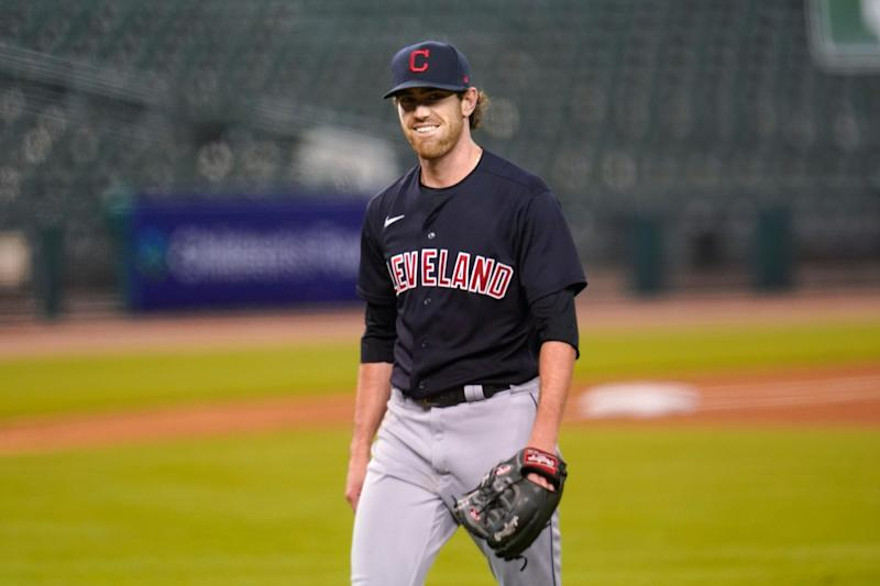 Cleveland Indians pitcher Shane Bieber smiles walking to the dugout in the fourth inning against the Detroit Tigers at Comerica Park, Thursday, Sept. 17, 2020.