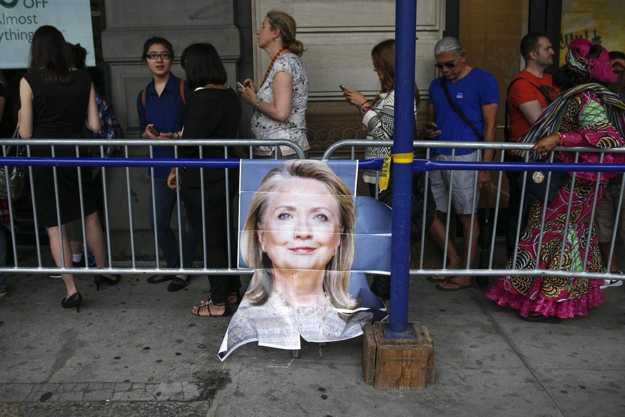 "People wait in line for a book signing by Hillary Clinton for her new book ""Hard Choices"" in New York June 10, 2014. The book, Clinton's fifth with publisher Simon and Schuster, will give the former secretary of state a chance to shape the debate about her record in the Obama administration, and reintroduce herself to voters as she tours the country. REUTERS/Shannon Stapleton (UNITED STATES - Tags: POLITICS ENTERTAINMENT)"