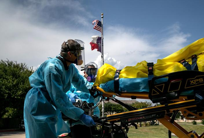 Image: Medics with Austin-Travis County EMS transport a nursing home resident with coronavirus symptoms on Aug. 3 in Austin, Texas. (John Moore / Getty Images file)