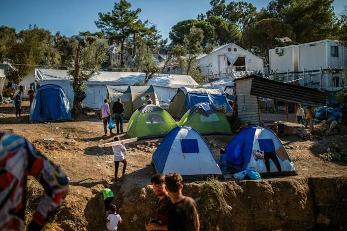 In addition to poor hygiene and frequent outbreaks of violence, many of the residents sleep in tents and complain of having to queue for hours to obtain food, take a shower or use a toilet (AFP Photo/ANGELOS TZORTZINIS)