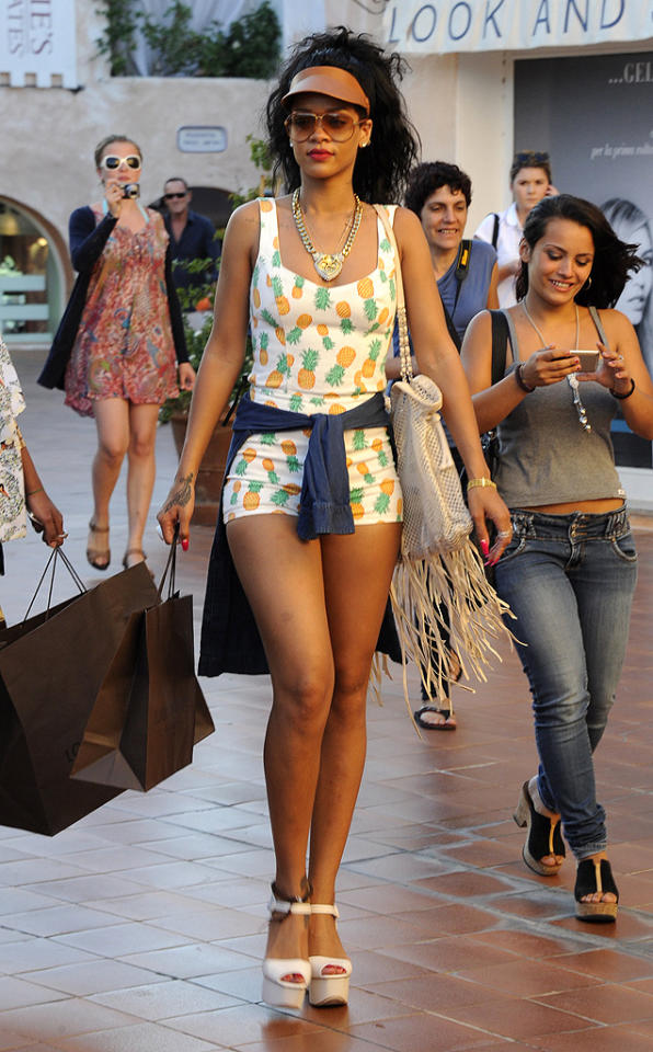 """Truth be told, we love the pineapple-print Topshop romper Rihanna wore while shopping in Sardinia. Unfortunately, her accessories -- including a fringed Chanel bag, chintzy-looking visor, over-sized sunglasses, and statement necklace -- took this look from trendy to tacky. (7/17/2012)<br><br><a target=""""_blank"""" href=""""http://omg.yahoo.com/news/rihanna-sues-ex-accountants-says-she-lost-millions-184451646.html"""">Rihanna sues former accountants</a>"""