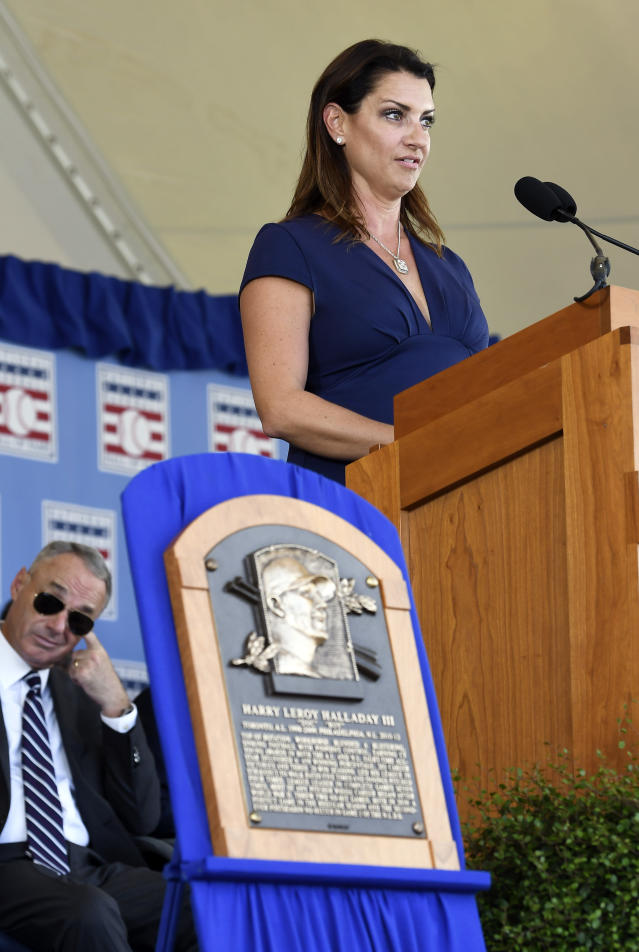 Brandy Halladay widow of Roy Halladay speaks as he is inducted posthumously into the National Baseball Hall of Fame during an induction ceremony at the Clark Sports Center on Sunday, July 21, 2019, in Cooperstown, N.Y. (AP Photo/Hans Pennink)