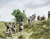 <p>Scottish troops head over a grassy mound during the Battle of the Canal du Nord in 1918 (Royston Leonard / Media Drum World / Caters News) </p>
