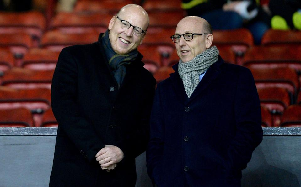 Manchester United co-chairman Joel Glazer (right) alongside his brother Avram - Glazers promise 'meaningful' Manchester United transfer spending but no 'outlandish' fees - PA