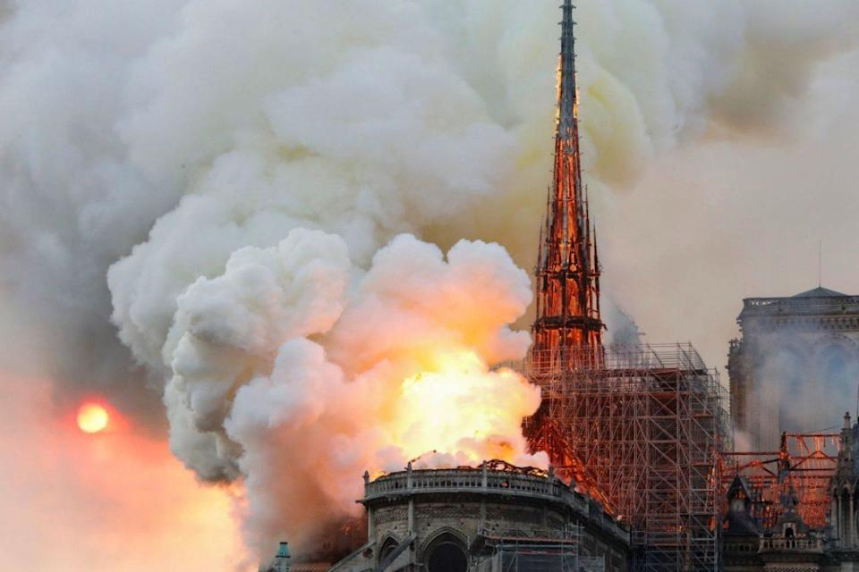 The fire ripped through Notre-Dame at 6.40pm on Monday, By 8pm, the blaze destroyed the cathedral's historic spire (AFP/GETTY)