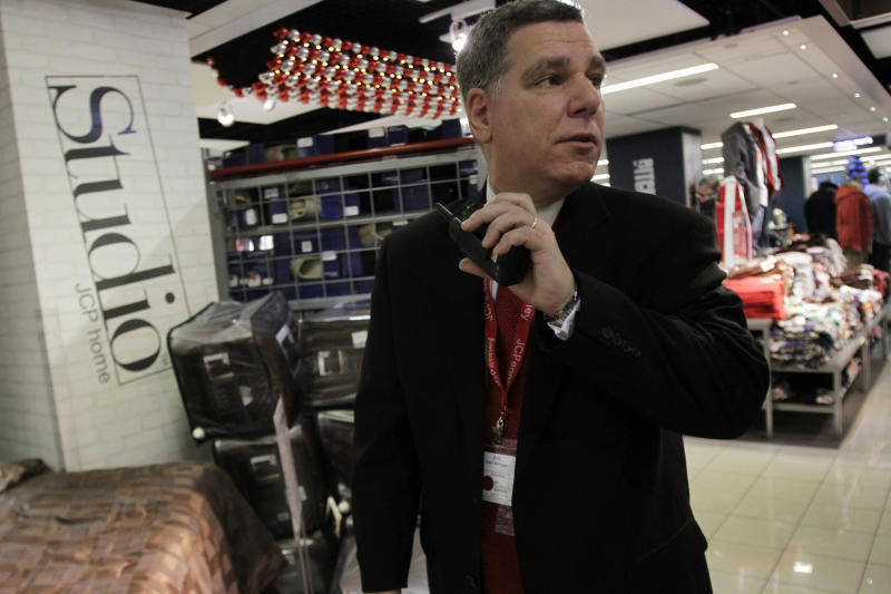 In this photo taken Saturday, Dec. 18, 2010, store manager Joe Cardamone inspects the store before opening for business at the Manhattan Mall J.C. Penney store in New York. (AP Photo/Mary Altaffer)