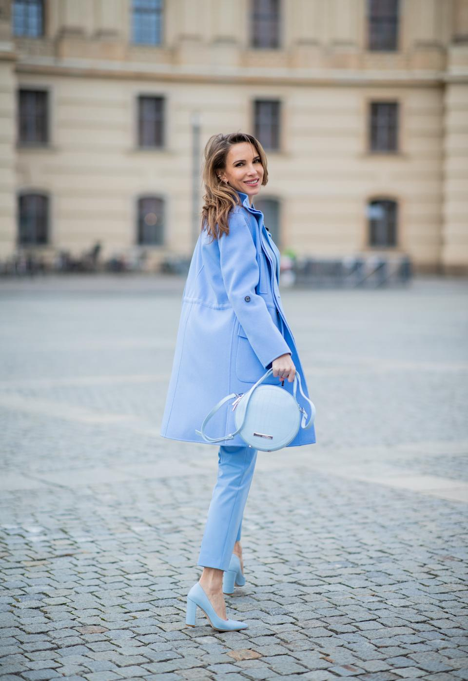 BERLIN, GERMANY - JANUARY 14: Alexandra Lapp is seen wearing total look Marc Cain: blue blazer, pants worn as a suit, round bag, blue shoes, wool coat during the Berlin Fashion Week Autumn/Winter 2020 on January 14, 2020 in Berlin, Germany. (Photo by Christian Vierig/Getty Images)