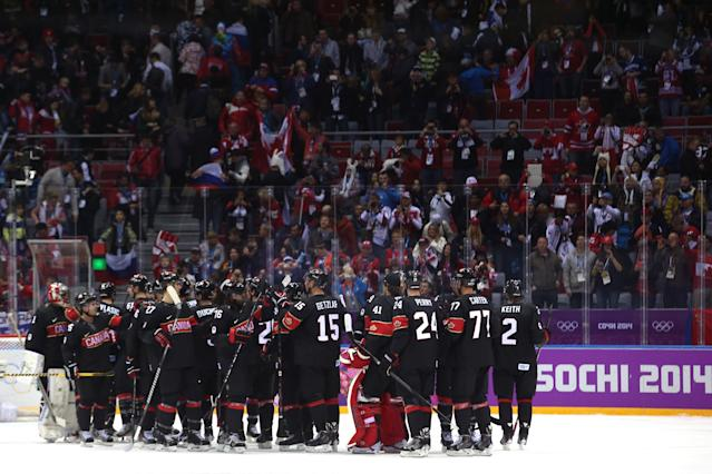 SOCHI, RUSSIA - FEBRUARY 14: Team Canada celebrates after defeating Austria 6 to 0 in the Men's Ice Hockey Preliminary Round Group B game on day seven of the Sochi 2014 Winter Olympics at Bolshoy Ice Dome on February 14, 2014 in Sochi, Russia. (Photo by Bruce Bennett/Getty Images)