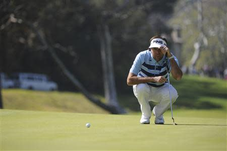 Feb 16, 2014; Pacific Palisades, CA, USA; Bubba Watson (USA) lines up a putt on the seventh green during the fourth round of the Northern Trust Open at Riviera Country Club. Andrew Fielding-USA TODAY Sports