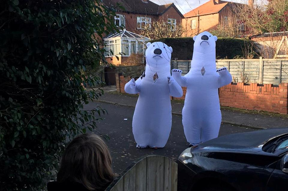 Grandparents Barbara, 71, and Clive Walshaw, 73, surprised their three grandsons by wearing a polar bear suit so they could hug for the first time since March. (Neil Walshaw/SWNS)