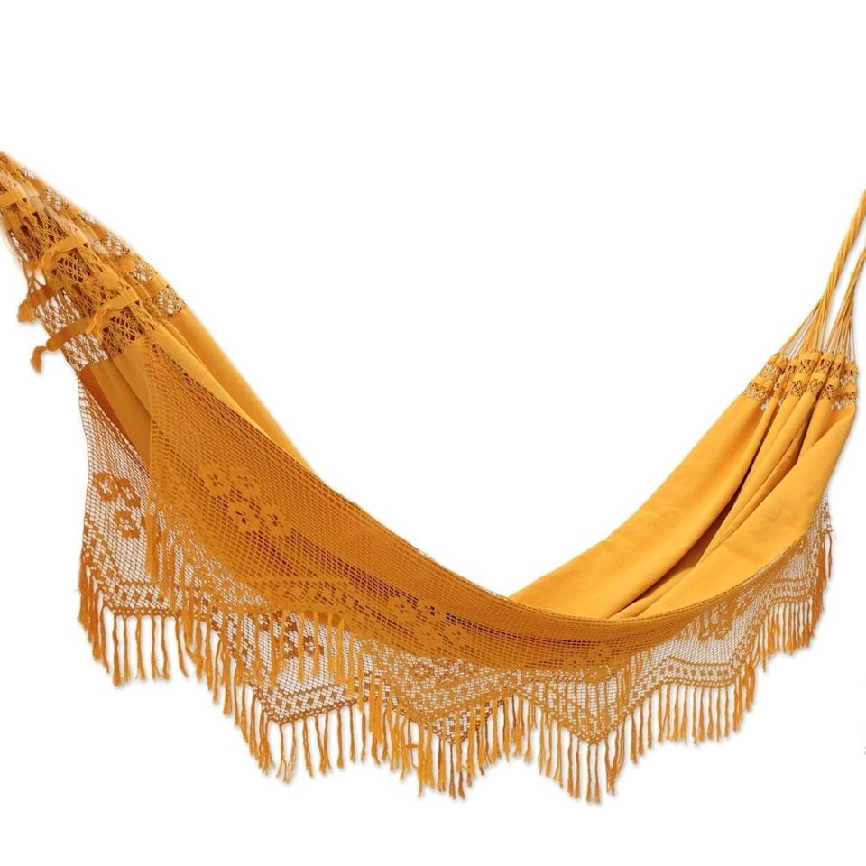 "<h3><a href=""https://www.overstock.com/Home-Garden/Handmade-Cotton-Belem-Sun-Hammock-Brazil/6341592/product.html"" rel=""nofollow noopener"" target=""_blank"" data-ylk=""slk:Novica Handmade Cotton Belem Sun Hammock"" class=""link rapid-noclick-resp"">Novica Handmade Cotton Belem Sun Hammock </a></h3><br><strong>When an outdoor oasis isn't in the building plan</strong>: Hang a cotton hammock from a nook inside your small space to bring the breezy outside vibes inside.<br><br><strong>Novica</strong> Handmade Cotton Belem Sun Hammock, $, available at <a href=""https://go.skimresources.com/?id=30283X879131&url=https%3A%2F%2Fwww.overstock.com%2FHome-Garden%2FHandmade-Cotton-Belem-Sun-Hammock-Brazil%2F6341592%2Fproduct.html"" rel=""nofollow noopener"" target=""_blank"" data-ylk=""slk:Overstock.com"" class=""link rapid-noclick-resp"">Overstock.com</a>"