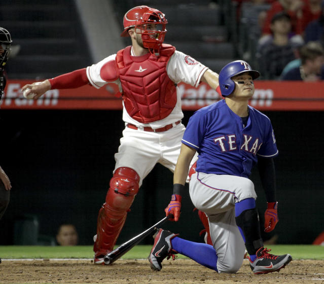 Texas Rangers' Shin-Soo Choo reacts after striking out against the Los Angeles Angels during the fifth inning of a baseball game in Anaheim, Calif., Tuesday, Sept. 25, 2018. (AP Photo/Chris Carlson)