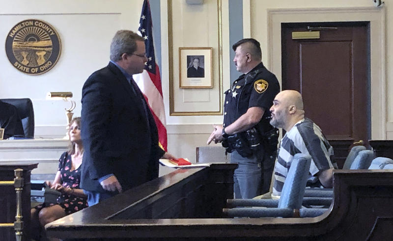 Ahmad Fawzi Issa, right, sits in Hamilton County Court Thursday May 30, 2019 in Cincinnati. Issa, 49, who was sentenced to death in 1998, appeared before a county judge after a federal appeals court threw out his conviction. Issa pleaded not guilty to aggravated murder in Hamilton County and will remain jailed without bond pending resolution of his case. Heis now off Ohio's death row after more than 20 years because his conviction was tossed is back in court and likely facing deportation to his native Jordan. (AP Photo/Dan Sewell)