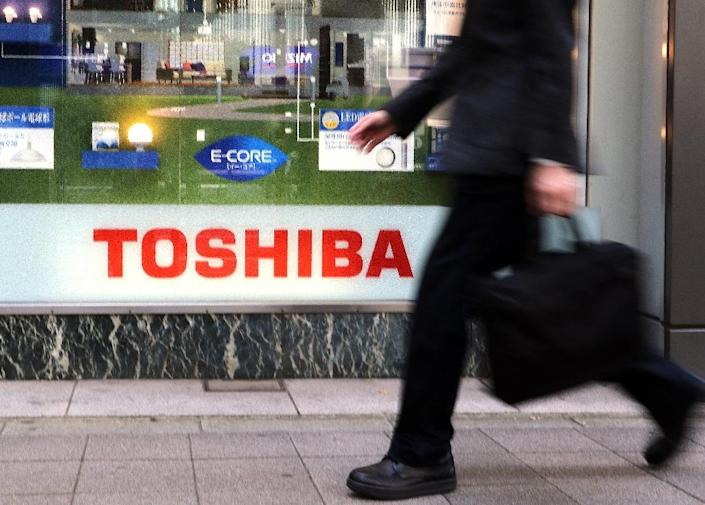Toshiba shares traded lower as the company expects to report a huge one-time loss related to the purchase of a nuclear service company (AFP Photo/YOSHIKAZU TSUNO)