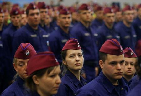 Hungarian border hunter recruits march at their swearing in ceremony in Budapest
