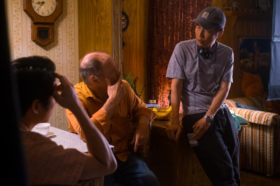 Actors Steven Yeun and Will Patton on set with director Lee Isaac Chung in Minari (Altitude)